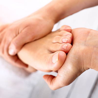 Reflexology - hands manipulating a foot